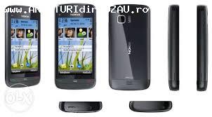 Vand carcasa telefon completa cu touch c5 si cu placa de baz